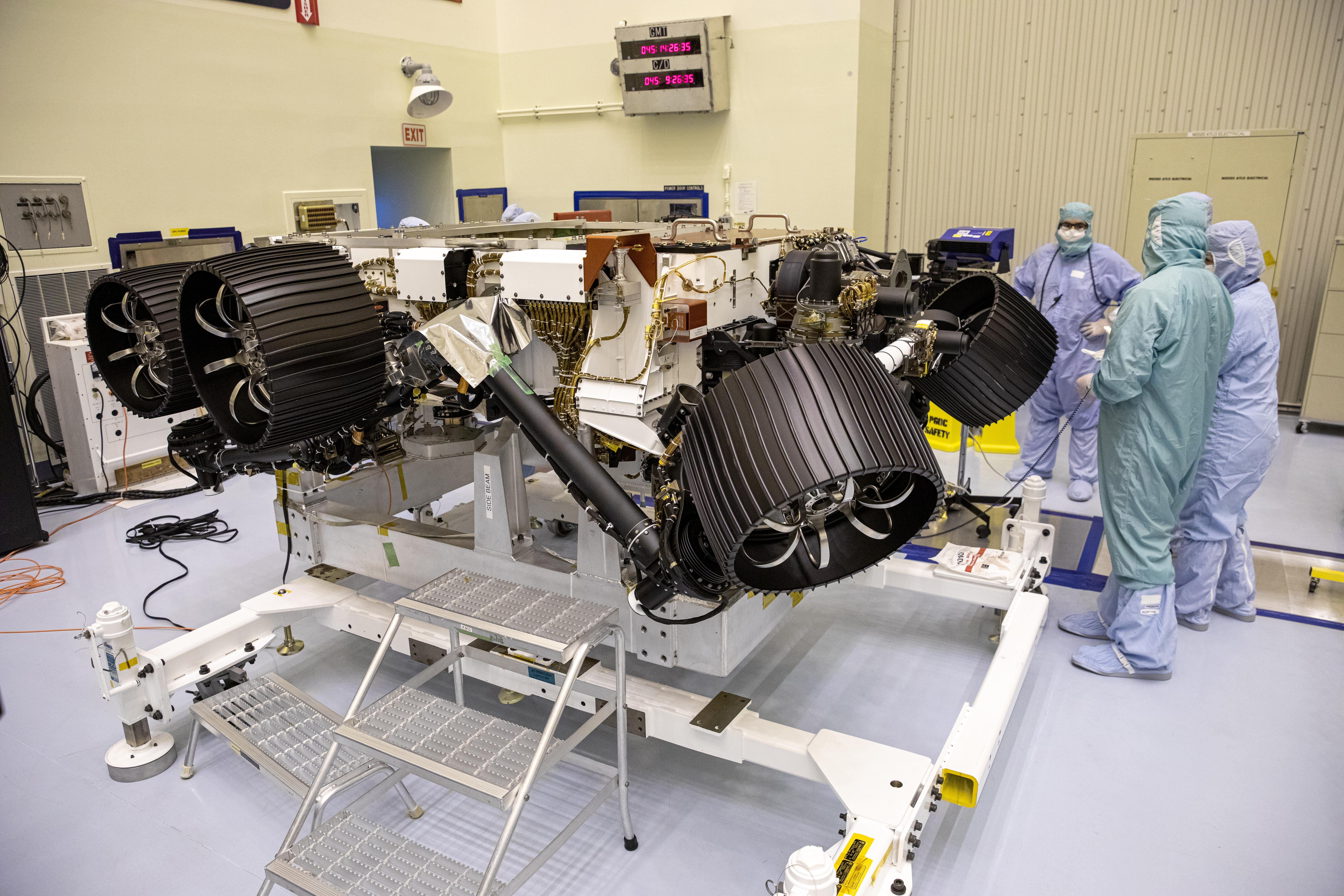NASAs Mars 2020 rover, now called Perseverance, undergoes processing at a payload servicing facility at NASAs Kennedy Space Center on Feb. 14, 2020.