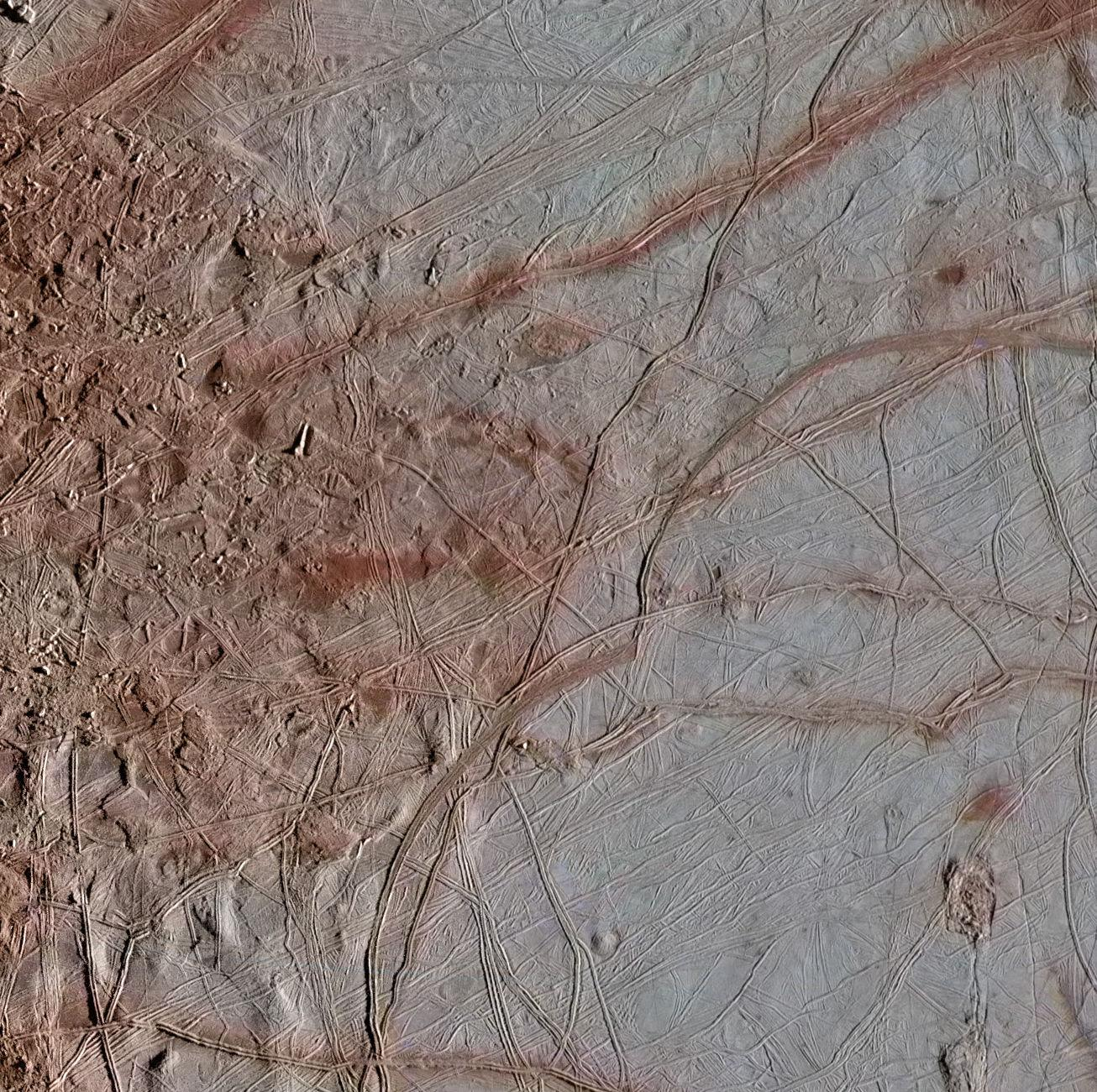 This newly reprocessed image of Jupiters moon Europa, taken by NASAs Galileo spacecraft on Sept. 26, 1998, reveals details of diverse surface features.