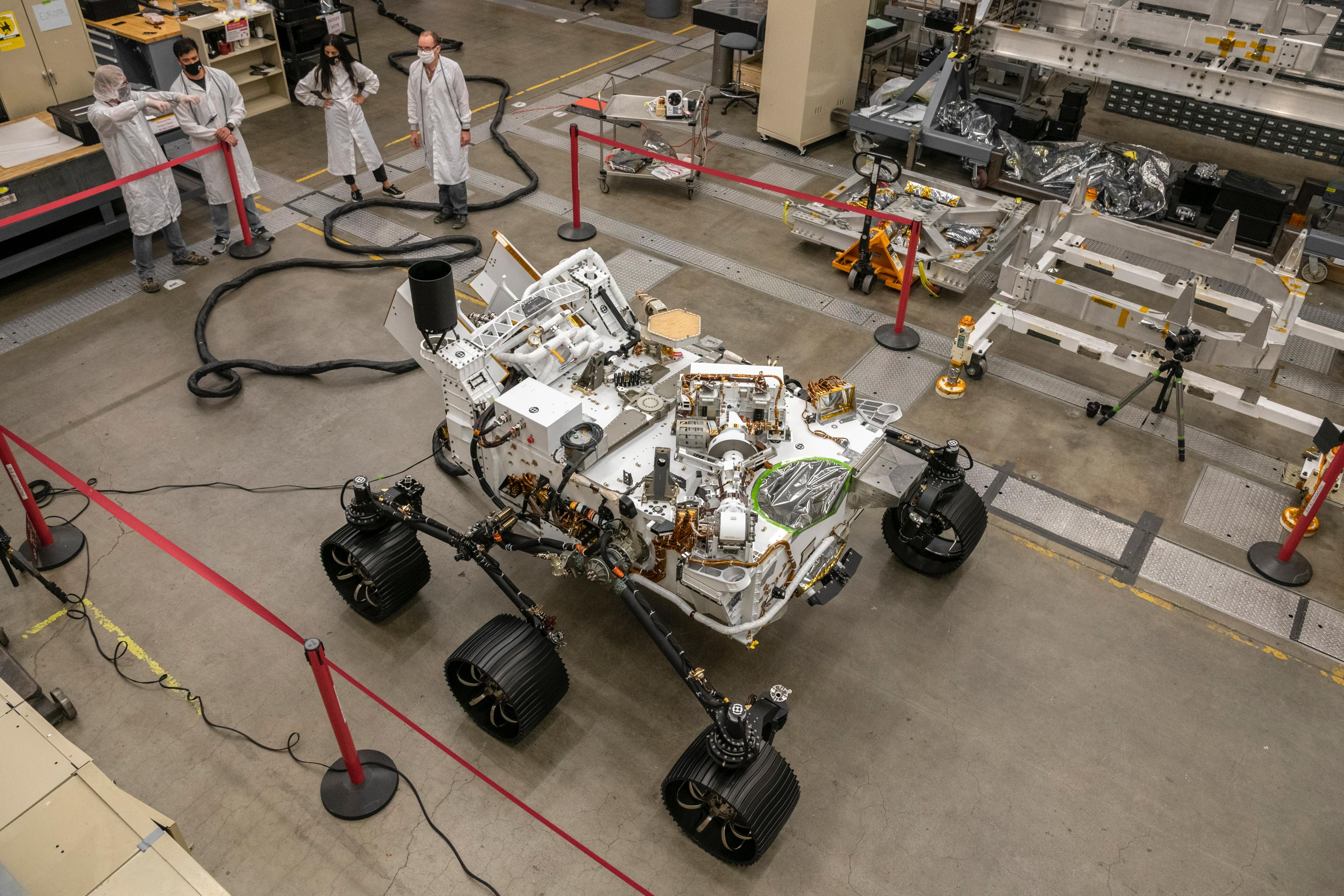 Engineers test drive the Earth-bound twin of NASAs Perseverance Mars rover for the first time in a warehouselike assembly room at the agencys Jet Propulsion Laboratory in Southern California.