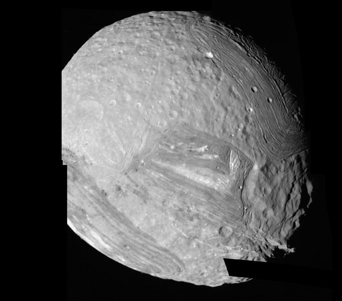 This mosaic of Miranda was obtained by NASA's Voyager 2 during its close flyby of the Uranian moon. Miranda exhibits varied geologic provinces where ridges and valleys of one province are cut off against the boundary of the next province.