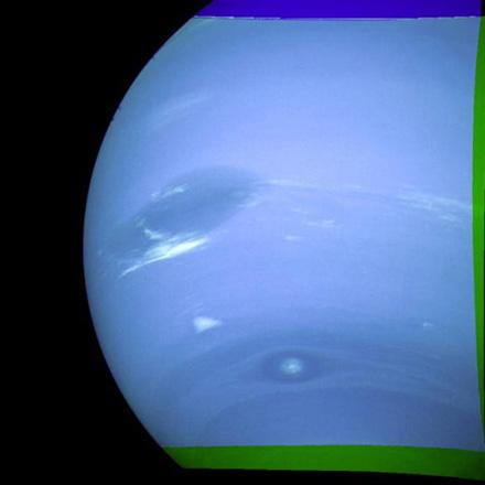 This photograph of Neptune was reconstructed from two images taken by NASA's Voyager 2. At the north (top) is the Great Dark Spot.