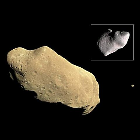 During its examination of the asteroid Ida, NASA's Galileo spacecraft returned images of a second object, Dactyl--the first confirmed satellite or moon of an asteroid; the much smaller moon is visible to the right of Ida.
