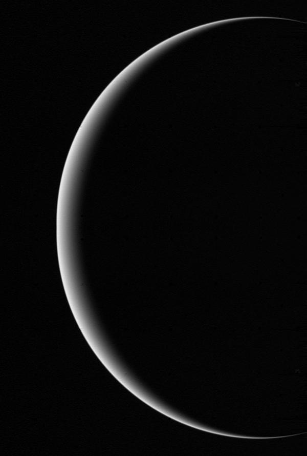 This image shows a crescent Uranus, a view that Earthlings never witnessed until Voyager 2 flew near and then beyond Uranus on Jan 24, 1986.