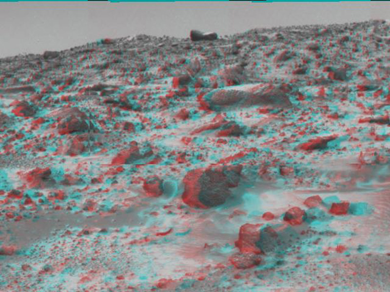 This area of terrain near the Sagan Memorial Station was taken by NASA's Mars Pathfinder. The curved rock dubbed 'Couch.' 3-D glasses are necessary to identify surface detail.