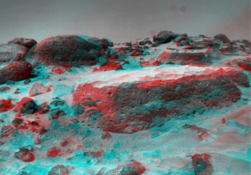 This anaglyph view of 'Flat Top,' due south of the lander, was produced by NASA's Mars Pathfinder's Imager camera. 3D glasses are necessary to identify surface detail.