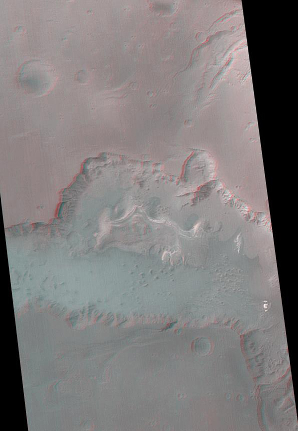 Ganges Chasma is part of the Valles Marineris trough system that stretches nearly 5,000 kilometers (3,000 miles) across the western equatorial region of Mars. This stereo anaglyph is from NASA's Mars Global Surveyor. 3D glasses are necessary.