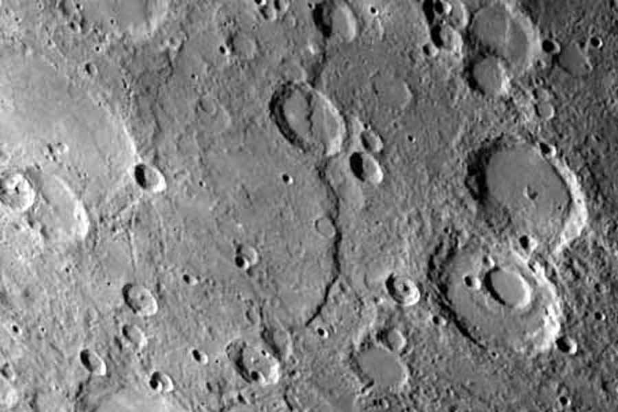 One of the most prominent lobate scarps (Discovery Scarp), photographed by NASA's Mariner 10 during it's first encounter with Mercury, is located at the center of this image (extending from the top to near bottom).