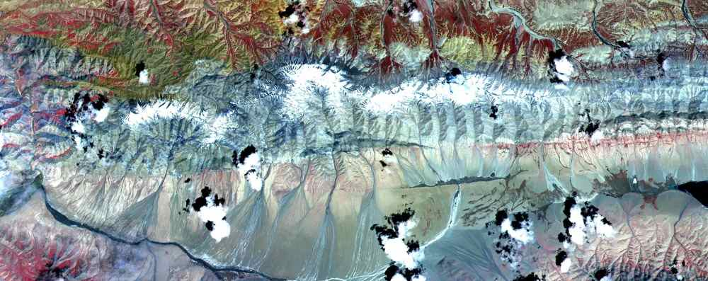 The Kunlun fault is one of the gigantic strike-slip faults that bound the north side of Tibet. NASA's Terra satellite acquired the scene on July 20, 2000.