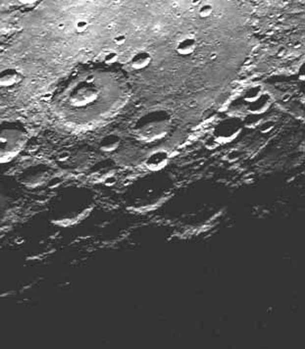 As NASA's Mariner 10 passed by Mercury on its second encounter with the planet on Sept. 21, 1974, this picture of a large circular (350 kilometer, 220 mile diameter) basin was obtained near the morning terminator.