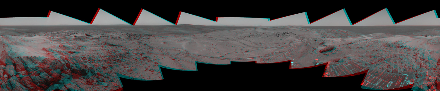 Before moving on to explore more of Mars, NASA's Mars Exploration Rover Spirit looked back at the long and winding trail of twin wheel tracks the rover created to get to the top of 'Husband Hill.' 3D glasses are necessary to view this image.