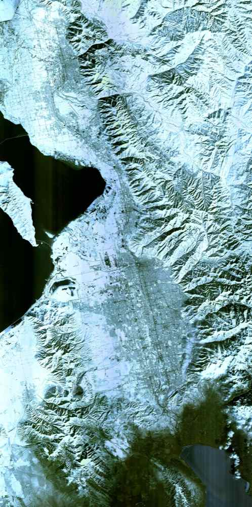 The 2002 Winter Olympics were hosted by Salt Lake City at several venues within the city, in nearby cities, and within the adjacent Wasatch Mountains. NASA's Terra satellite captured this image on February 8, 2001.