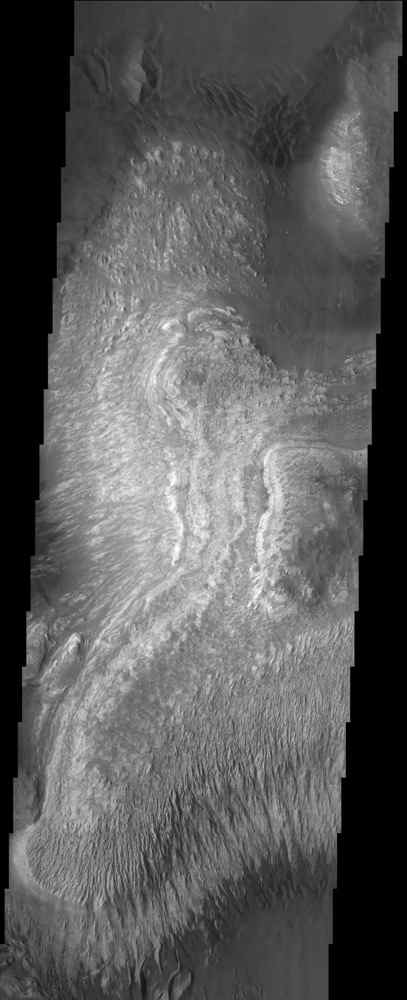 These layered deposits are located on the floor of a large canyon called Ganges Chasma which is a part of the Valles Marineris in this image captured by NASA's 2001 Mars Odyssey spacecraft.