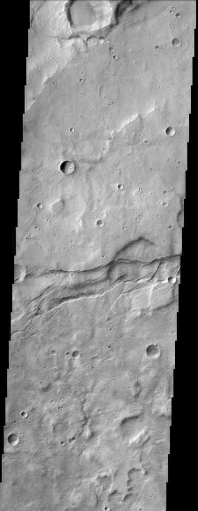 This image from NASA's Mars Odyssey spacecraft shows the cratered highlands of Terra Sirenum in Mars' southern hemisphere. Near the center of the image running from left to right one can see long parallel to semi-parallel troughs called graben.