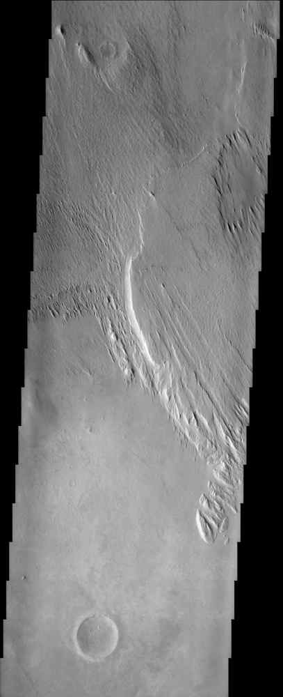 This image from NASA's Mars Odyssey shows a Martian geologic deposit known as the Medusae Fossae Formation (the raised plateau in the upper two-thirds of the image), a soft, easily eroded deposit that extends for nearly 1,000 km along the equator of Mars.