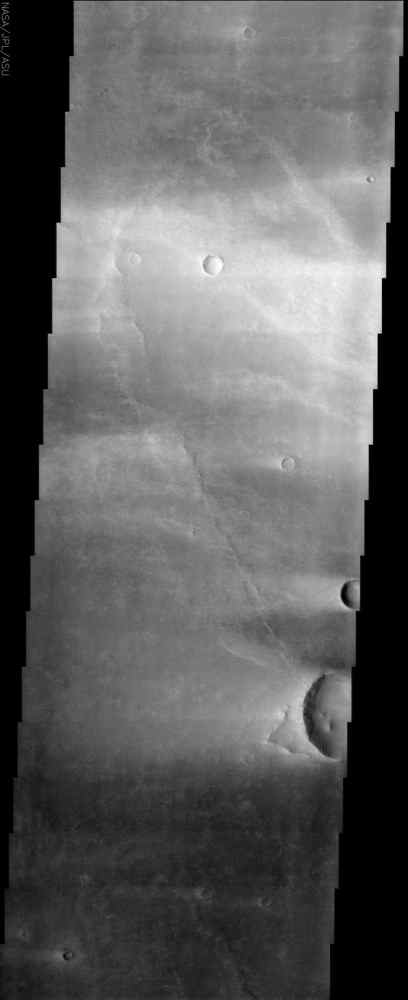 This image from NASA's Mars Odyssey spacecraft is from the region of Syrtis Major, which is dominated by a low-relief shield volcano and believed to be an area of vigorous aeolian activity with strong winds in the east-west direction.