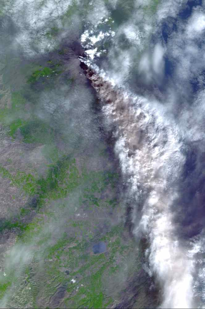 On Sunday, November 3, 2002, Mt. Etna's ash-laden plume was imaged by NASA's Terra satellite. The plume is seen blowing toward the south-southeast, over the city and airport of Catania, Sicily.