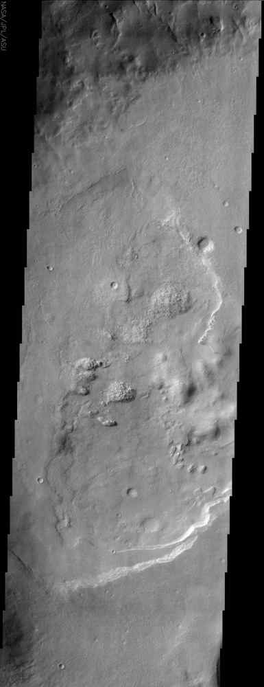 Lineations (fissures, or cracks in the ground) can be seen in this image of Acidalia Planitia from NASA's Mars Odyssey spacecraft and create what is referred to as 'patterned ground' or 'polygonal terrain.'