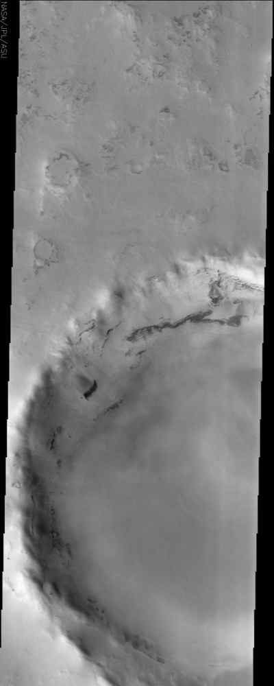 This image from NASA's Mars Odyssey spacecraft displays a frosted crater in the Martian northern hemisphere. It was taken during the northern spring, when the CO2 ice cap starts to sublimate and recede.