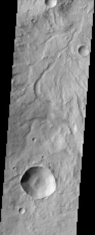 This image by NASA's Mars Odyssey spacecraft shows the rugged cratered highland region of Libya Montes, which forms part of the rim of an ancient impact basin called Isidis.