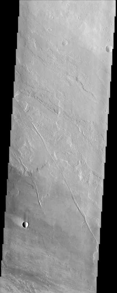This image from NASA's Mars Odyssey of lava flows around the large scarp of Olympus Mons reveals textures characteristic of the variable surface roughness associated with different lava flows in this region.