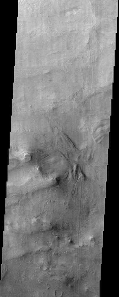 With a diameter of roughly 2,000 km (1,243 miles) and a depth of over 7 km (more than 4 miles), the Hellas Basin, shown in this image from NASA's Mars Odyssey spacecraft, is the largest impact feature on Mars.