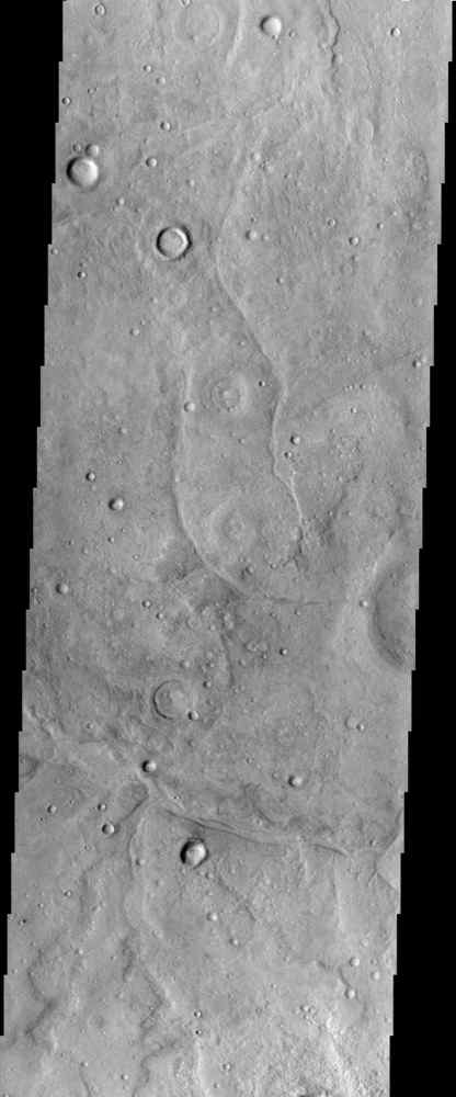 This image from NASA's Mars Odyssey is of a region of Mars called Tempe Terra, which is located between the topographically high Tharsis Region and Acidalia Planitia, a large low albedo region of in the Martian northern hemisphere.