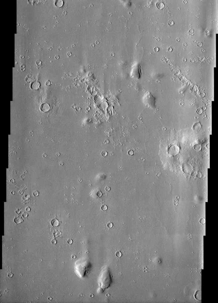 Impact craters in Hecates Tholus, as seen in this image from NASA's Mars Odyssey spacecraft, appear to be filled with sediment derived from erosion of the surrounding terrain.