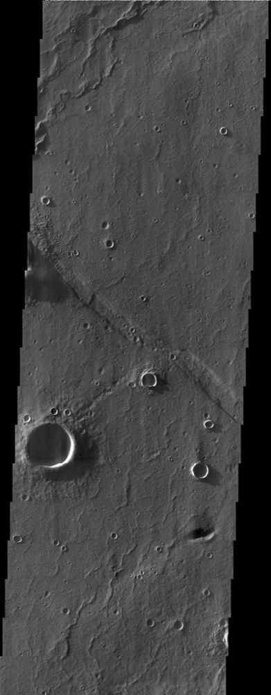 At first glance, this NASA Mars Odyssey image showing impact craters and linear ridges and troughs is typical of the southern highlands. However, upon closer examination migrating sand dunes are observed within the troughs.