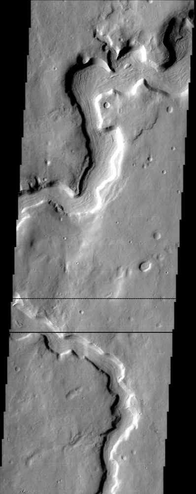 In this image from NASA's Mars Odyssey spacecraft, striations on the floor of this sinuous channel adjacent to Protonilus Mensae look like they result from the flow of lava or perhaps even glacial ice.