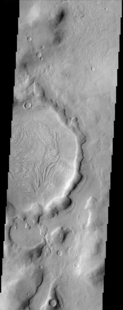 The bizarre patterns on the floor of this crater in Nilosyrtis Mensae imaged by NASA's Mars Odyssey defy an easy explanation. It is possible that some form of periglacial process combined with the vaporization of ground ice to form these patterns.