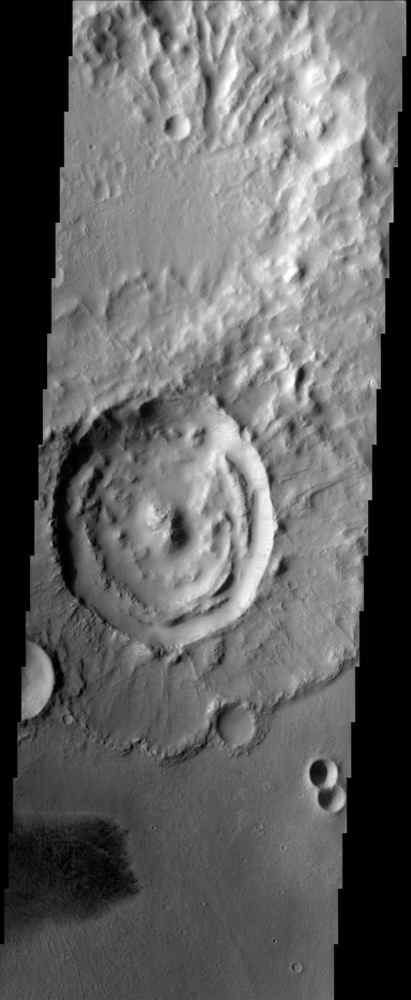 This image from NASA's Mars Odyssey spacecraft shows an impact crater with a rampart ejecta blanket in Arabia Terra.