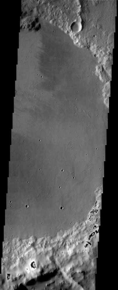 The floor of the crater in this NASA Mars Odyssey image displays interesting textures and it appears to have been flooded by some type of material. It is unclear if this material was fluvially emplaced mud (hyperconcentrated flows) or lava.