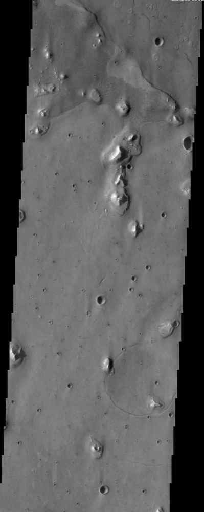 This is an image from NASA's Mars Odyssey spacecraft of an area within Acidalia Planitia that contains patterned ground (near the top of the image). This type of surface is likely related to subsurface ice.