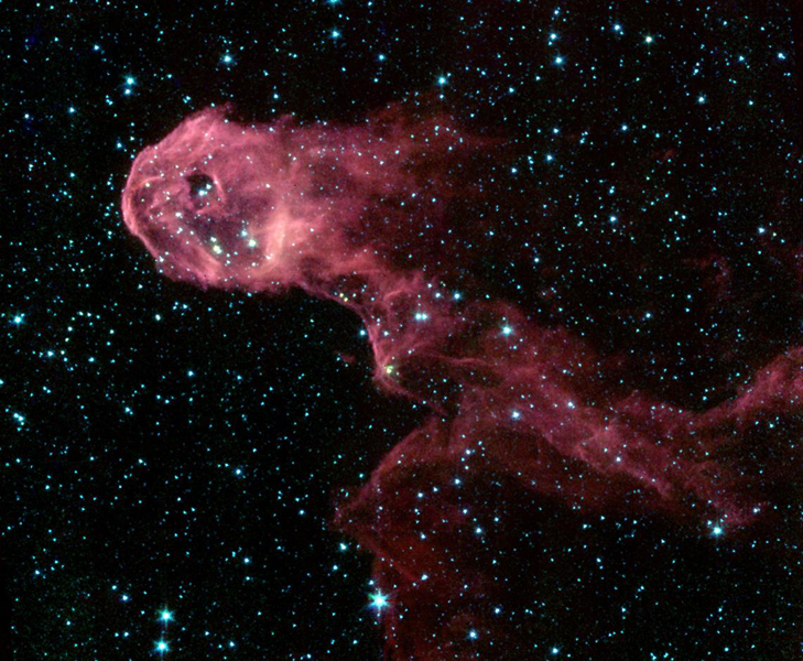 NASA's Spitzer Space Telescope image of a glowing stellar nursery provides a spectacular contrast to the opaque cloud seen in visible light (inset).