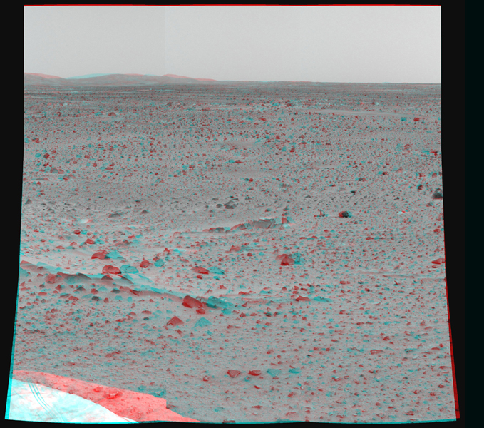 Martian terrain is seen in this 3-D image taken by the panoramic camera on NASA's Mars Exploration Rover Spirit. 3D glasses are necessary to view this image.