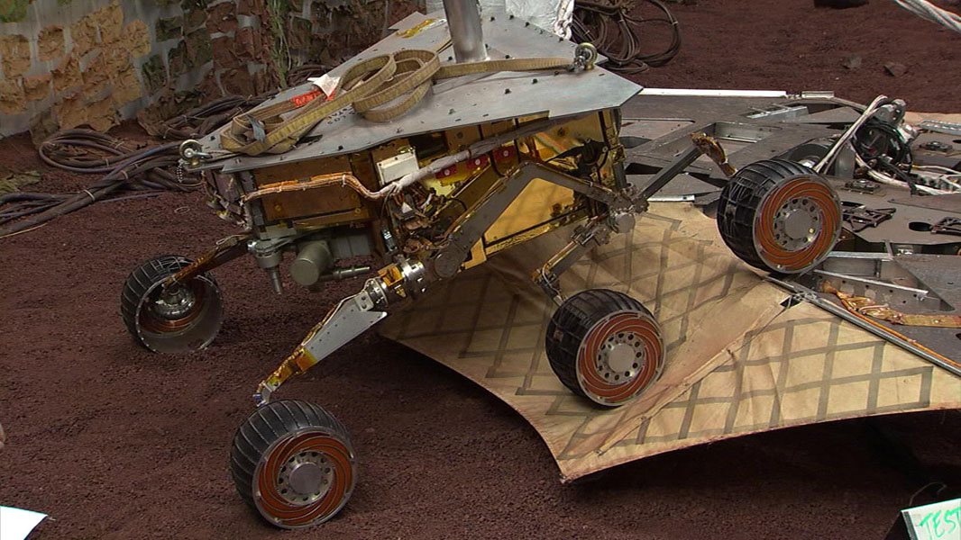 This still image illustrates what the Mars Exploration Rover Spirit will look like as it rolls off the northeastern side of the lander on Mars. The image was taken from footage of rover testing at JPL's In-Situ Instruments Laboratory, or 'Testbed.'
