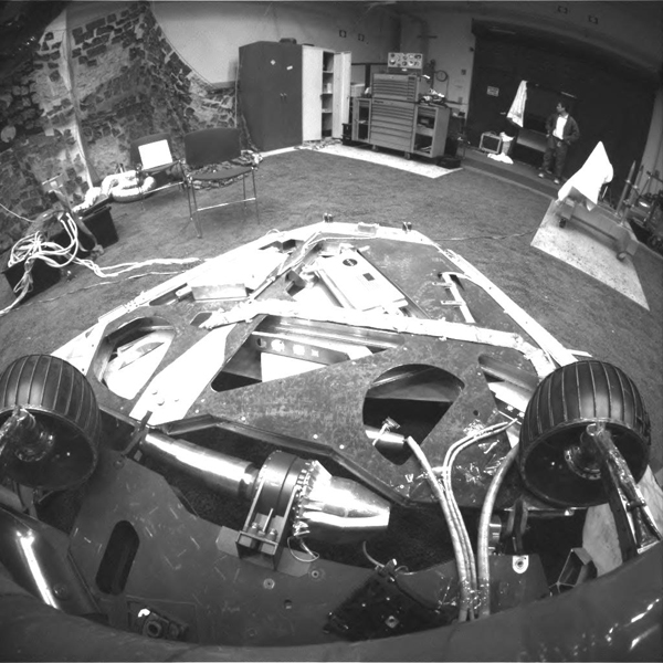 "This image, taken in the JPL In-Situ Instruments Laboratory or ""Testbed,"" shows the view from the front hazard avoidance cameras on the Mars Exploration Rover Spirit after the rover has backed up and turned 45 degrees counterclockwise."