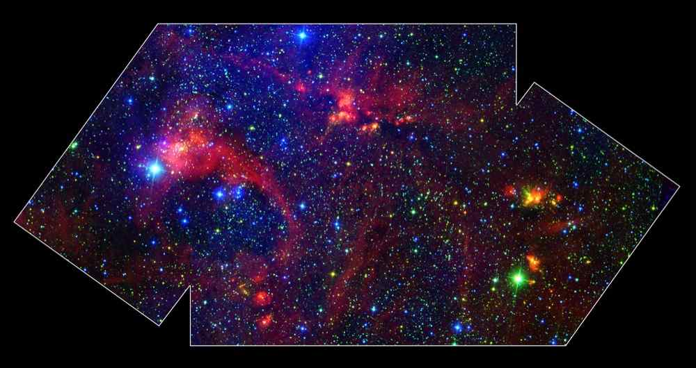 Images From NASAs Spitzer Space Telescope Allow Us To Peek Behind The Cosmic Veil And Pinpoint