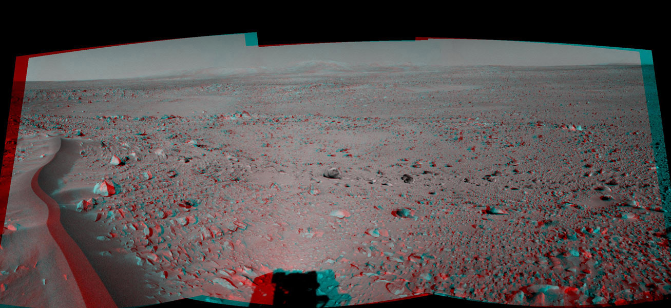This 120-degree three dimensional anaglyph view from NASA's Mars Exploration Rover Spirit highlights a crater approximately 70 meters (230 feet) in diameter informally named 'Lahontan.' 3D glasses are necessary to view this image.