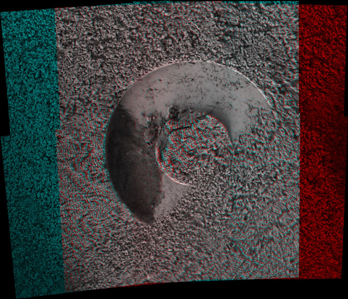 NASA's Mars Exploration Rover microscopic imager onboard Spirit revealed a gap less than half an inch in the imprint left behind in the soil. 3D glasses are necessary to view this image.