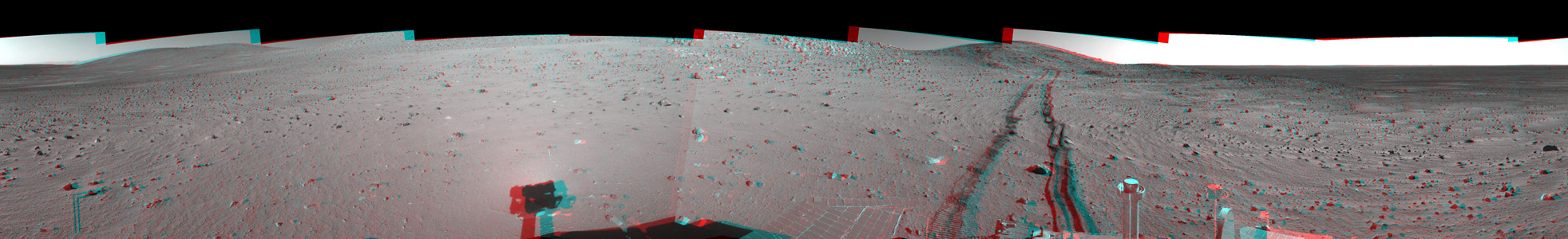 This site, labeled Spirit site 93, is in the 'Columbia Hills' inside Gusev Crater. NASA's Mars Exporation rover Spirit's tracks point westward. 3D glasses are necessary to view this image.