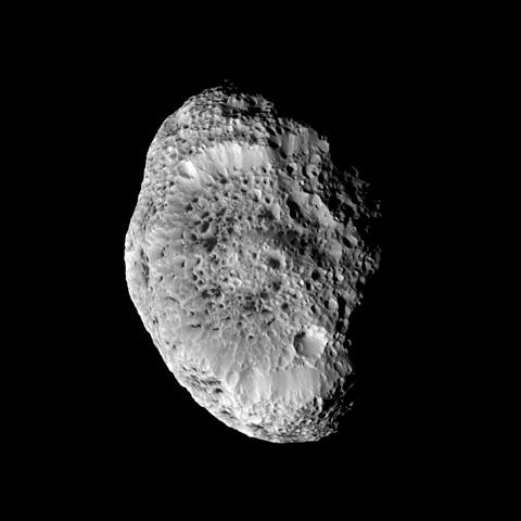 Saturn's impact-pummeled moon Hyperion stares back at the Cassini spacecraft in this six-image mosaic, taken during the spacecraft's close approach on Sept. 26, 2005.