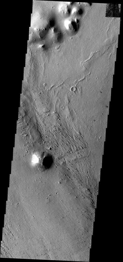 Small ripple-like dunes surround hills in the region of Elysium Planitia in this image from NASA's Mars Odyssey spacecraft.
