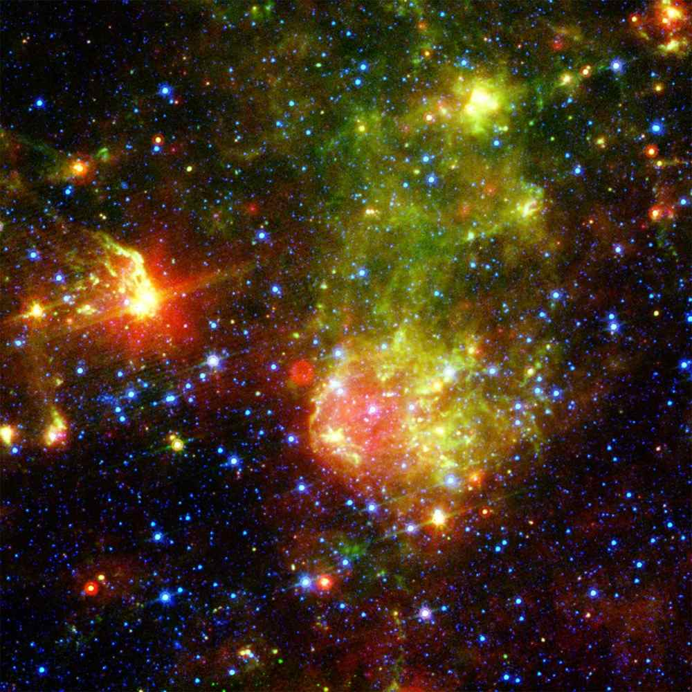 NASA's Spitzer Space Telescope shows the supernova remnant 1E0102.2-7219 sits next to the nebula N76 in a bright, star-forming region of the Small Magellanic Cloud, a satellite galaxy to our Milky Way galaxy.