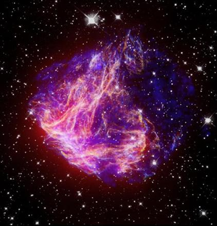 This is a composite image of N49, the brightest supernova remnant in optical light in the Large Magellanic Cloud; the image combines data from the Chandra X-ray Telescope (blue) and NASA's Spitzer Space Telescope (red).