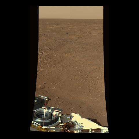 This approximate color view was obtained on sol 2 by the Surface Stereo Imager (SSI) on board NASA's Mars Phoenix lander. The view is toward the northwest, showing polygonal terrain near the lander and out to the horizon.