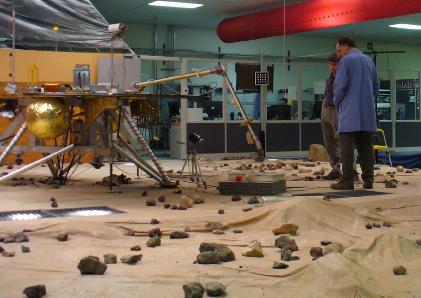 Members of NASA Phoenix Mars Mission's Robotic Arm engineering team test the arm's motorized rasp in the Payload Interoperability Testbed at the University of Arizona, Tucson.