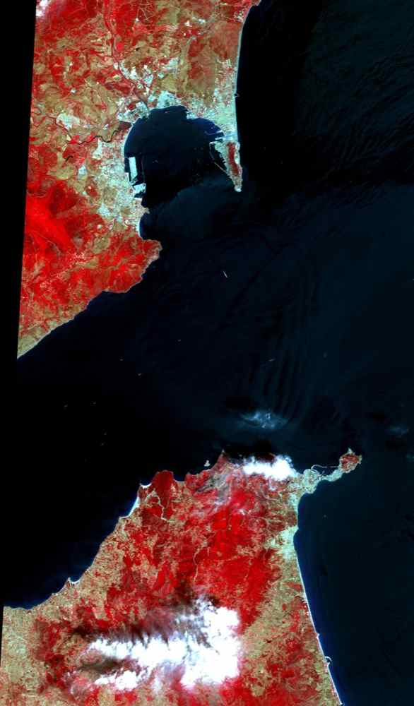 This image acquired by NASA's Terra satellite on July 5, 2000 covers the eastern part of the Strait of Gibraltar, separating Spain from Morocco. The promontory on the eastern side of the conspicuous Spanish port is the Rock of Gibraltar.
