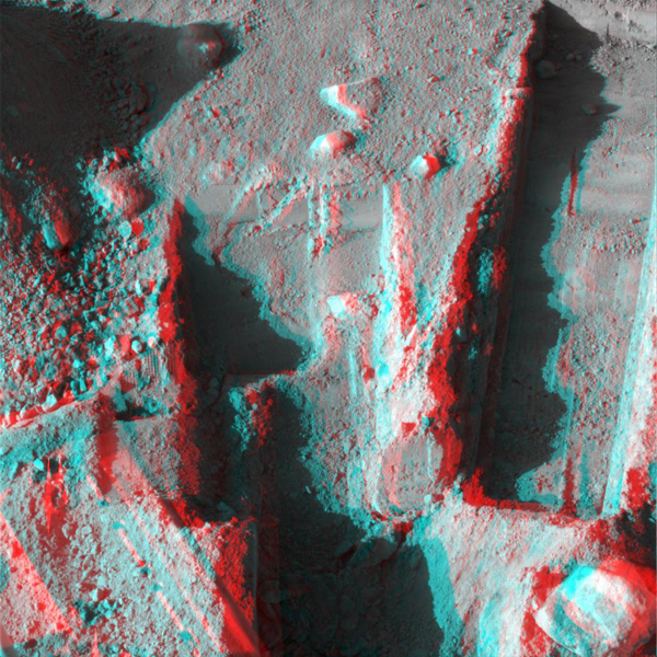 NASA's Phoenix Mars Lander took this anaglyph on Oct. 21, 2008; the trench on the upper left is called 'Dodo-Goldilocks.' 3-D glasses are necessary to view this image.