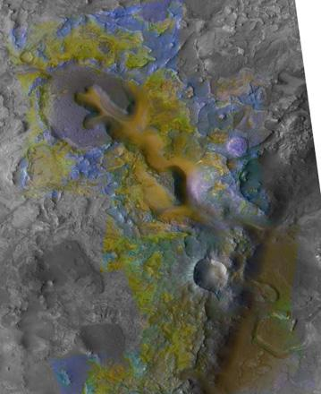 The color coding on this CRISM composite image of an area on Mars is based on infrared spectral information interpreted as evidence of various minerals present. Carbonate, which is indicative of a wet and non-acidic history, occurs in very small patches.